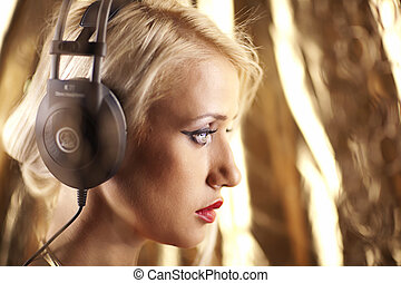Beautiful model with headphones shoot from one side.