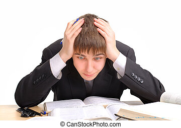hard work - shocked teenager studying hard for the exam