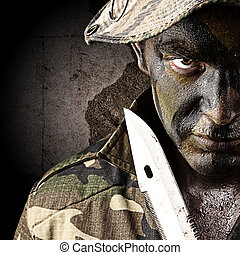 young soldier - portrait of young soldier threating to...