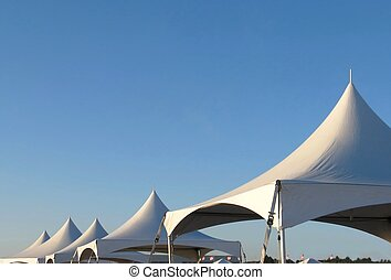 tent tops - white tent tops against a clear blue sky