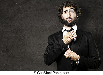 young man - portrait of young man adjusting his suit against...