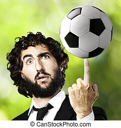 young man with a soccer ball