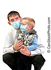 young man and kid in the flu mask