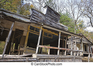 Ghost Store Front - An old and abandoned store front sits...