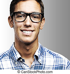 young man smiling - portrait of young man with shirt and...