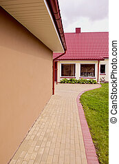 House with large windows and red tiled roof. - The new...