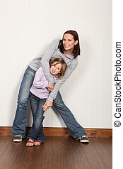 Embrace of family love and fun for mother daughter