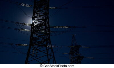 Pylon and moon - Electricity pylon and moving moon
