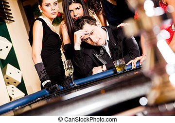 Young people behind roulette table