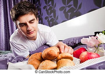 Male having breakfast in bed