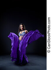 girl dance in dark - oriental flying purple cloth