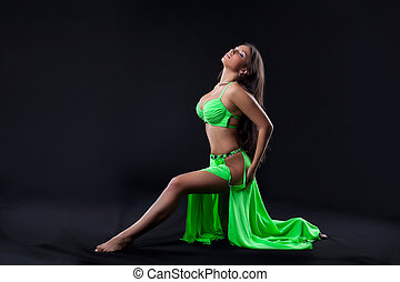 Beautiful young girl dance in green arabic costume
