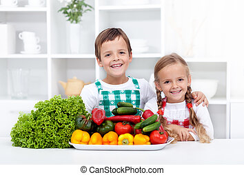 Happy healthy kids with vegetables