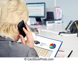 Analyzing data . - Woman on a phone analyzing financial data...