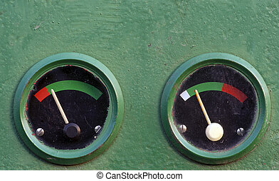 Gauge meters - Two gauge meters on dashboard of vintage...