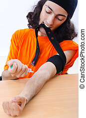 Young druc addict with syringe