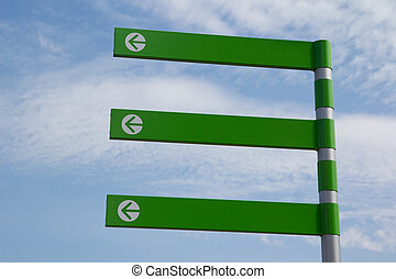 Green Arrow Sign - A Green Empty Directional Arrow Sign with...