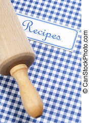 cookbook and kitchenware - Blue cookbook and rolling pin