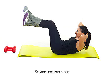 Woman doing abs and sitting on yellow mat against white...