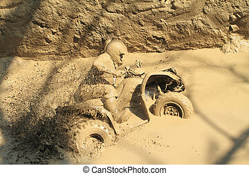 man badly stuck in mud with his quadbike - young man badly...
