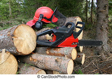 Logger equipment with cut trees - Chainsaw and helmet with...