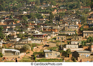 Hills of life - The view of housing against a hill, Rwanda