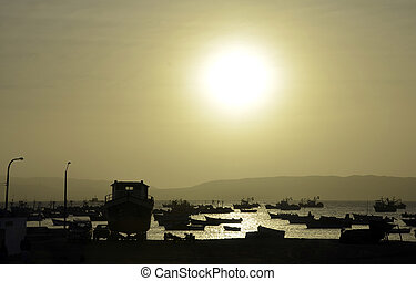Bay Full of Fishing boats with Setting Sun