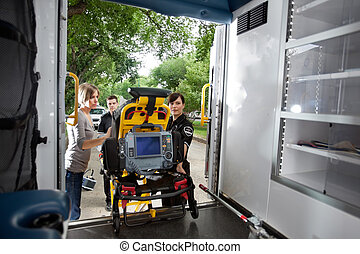 Loading Patient in Ambulance - Emergency team loading...