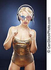 Beautiful girl in gold swimwear