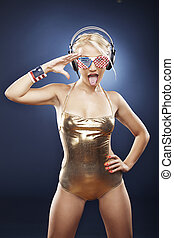 Blond model in gold swimwear and American inspired accessories.
