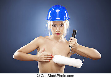 Topless model holding a roller brush. - Beautiful topless...