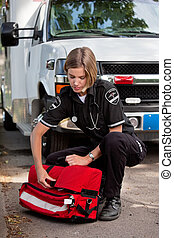 EMS Professional with Portable Oxygen Unit - Emergency...