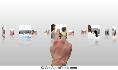 Hand choosing clips about families at home having fun
