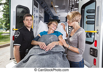 Elderly Emergency Care - Senior woman being taken on...