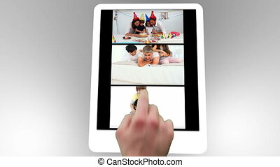 Tablet being used to watch two short family films without...
