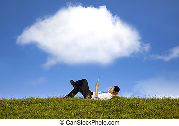 cloud background and happy businessman working with tablet...
