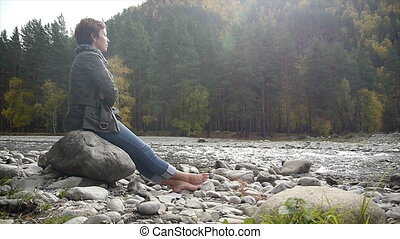young woman meditating on the nature