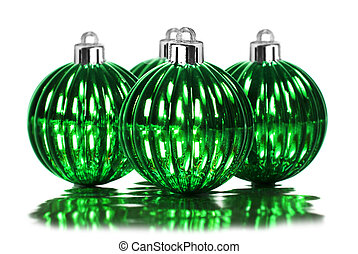 Green christmas decoration baubles on a white