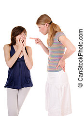 Scolding - One young woman is scolding another girl on white...