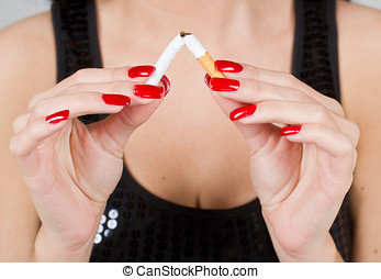 non smoking - Woman hands breaking cigarette