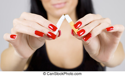 non smoking - Woman hands breaking cigarette.