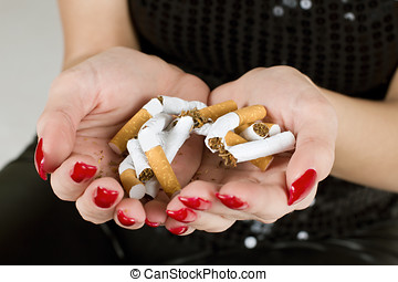non smoking - Female hands holding broken cigarette.