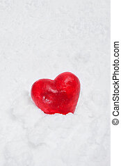cold love - a red heart on the white snow
