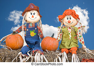 Scarecrow Couple - Scarecrow couple sitting on hay bales