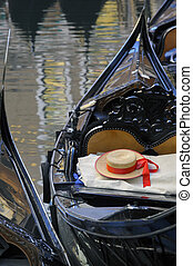 Gondoliers straw hat in boat, Venice