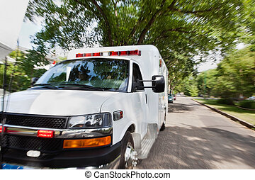 Ambulance on Street - Ambulance vehicle travelling to...