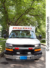 Ambulance on Street - Ambulance on street in residential...