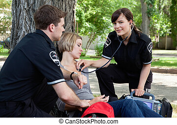 Portrait of CFR - Emergency medical professionals assessing...