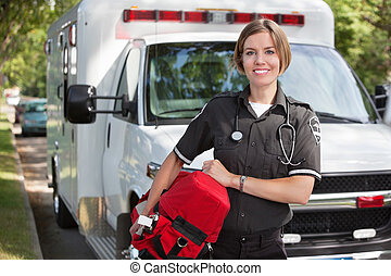 Paramedic with Oxygen Unit - Portrait of a happy paramedica...
