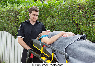 Ambulance Stretcher - Male emergency worker pushing a...